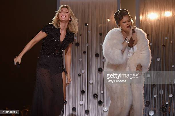 Singers Ellie Goulding and Andra Day perform onstage during The 58th GRAMMY Awards at Staples Center on February 15 2016 in Los Angeles California