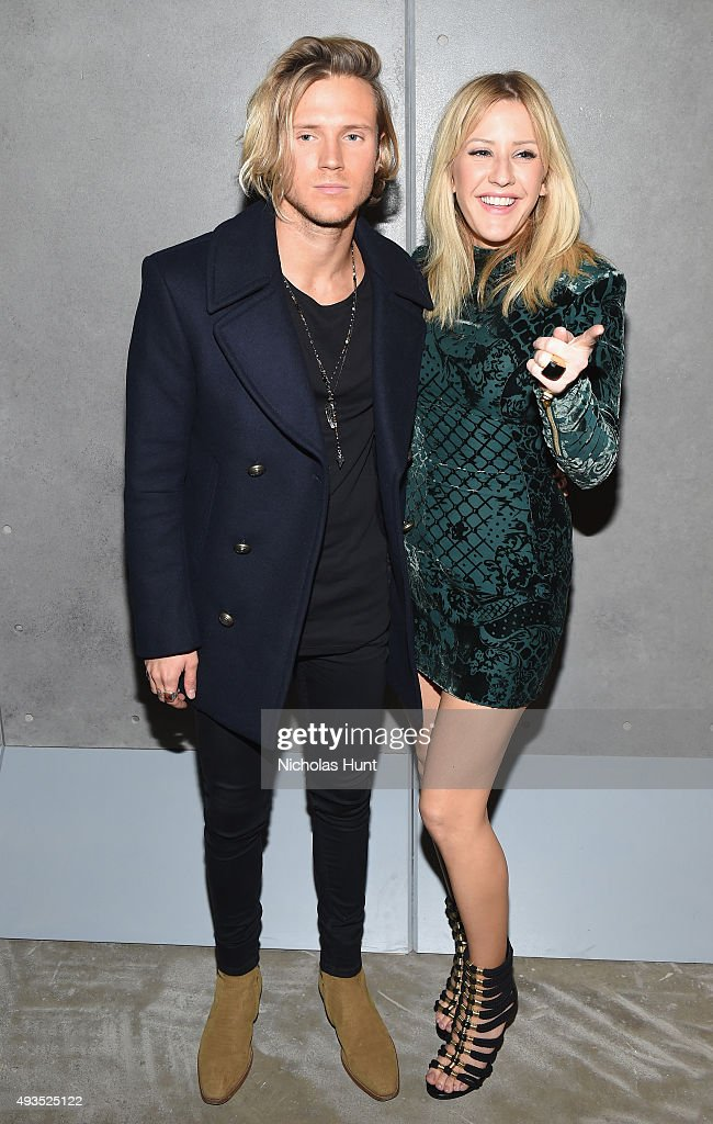 Singers Ellie Goulding (R) and Dougie Poynter attend the BALMAIN X H&M Collection Launch at 23 Wall Street on October 20, 2015 in New York City.