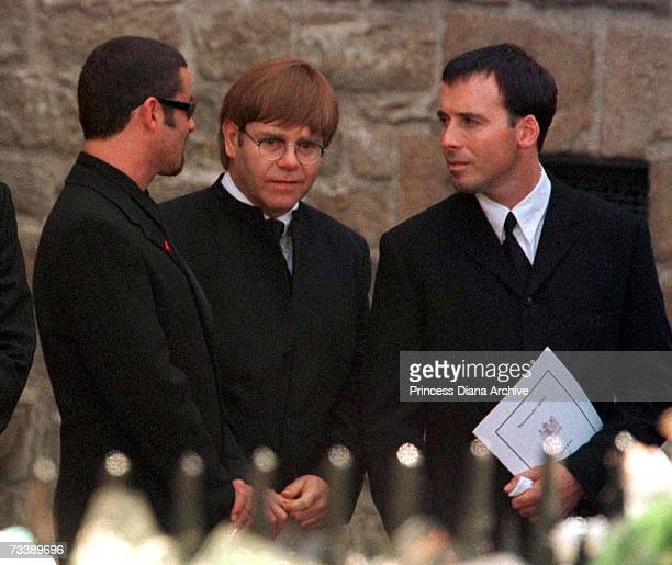 Singers Elton John and George Michael leaving Westminster Abbey after the funeral service for Princess Diana Princess of Wales 6th September 1997...