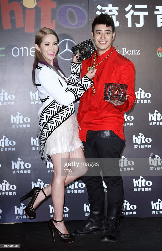 Singers <a gi-track='captionPersonalityLinkClicked' href=/galleries/search?phrase=Elva+Hsiao&family=editorial&specificpeople=4533026 ng-click='$event.stopPropagation()'>Elva Hsiao</a> and <a gi-track='captionPersonalityLinkClicked' href=/galleries/search?phrase=Wilber+Pan&family=editorial&specificpeople=644324 ng-click='$event.stopPropagation()'>Wilber Pan</a> (R) attend 2013 Hito Music Awards at Taipei Arena on June 2, 2013 in Taipei, Taiwan.