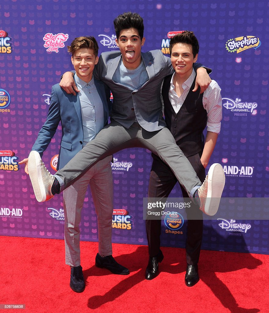 Singers Emery Kelly, Ricky Garcia, and Liam Attridge of Forever In Your Mind arrive at the 2016 Radio Disney Music Awards at Microsoft Theater on April 30, 2016 in Los Angeles, California.