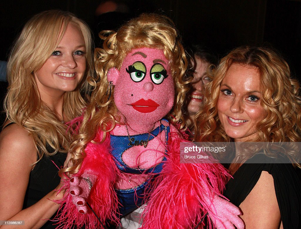 COVERAGE* Singers <a gi-track='captionPersonalityLinkClicked' href=/galleries/search?phrase=Emma+Bunton&family=editorial&specificpeople=201973 ng-click='$event.stopPropagation()'>Emma Bunton</a> aka 'Baby Spice' and <a gi-track='captionPersonalityLinkClicked' href=/galleries/search?phrase=Geri+Halliwell&family=editorial&specificpeople=157601 ng-click='$event.stopPropagation()'>Geri Halliwell</a> aka 'Ginger Spice' of The <a gi-track='captionPersonalityLinkClicked' href=/galleries/search?phrase=Spice+Girls&family=editorial&specificpeople=534365 ng-click='$event.stopPropagation()'>Spice Girls</a> pose with 'Lucy The Slut' backstage at 'Avenue Q' on Broadway at The John Golden Theater on February 8, 2008 in New York City.