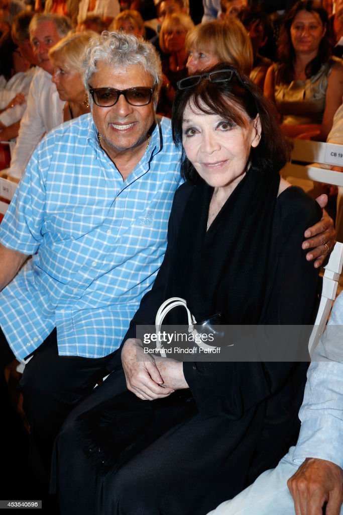 Singers <a gi-track='captionPersonalityLinkClicked' href=/galleries/search?phrase=Enrico+Macias&family=editorial&specificpeople=2057443 ng-click='$event.stopPropagation()'>Enrico Macias</a> and <a gi-track='captionPersonalityLinkClicked' href=/galleries/search?phrase=Juliette+Greco&family=editorial&specificpeople=210869 ng-click='$event.stopPropagation()'>Juliette Greco</a> attend the Michel Boujenah's show 'Ma vie revee' for the last evening of the 30th Ramatuelle Festival : Day 12 on August 12, 2014 in Ramatuelle, France.