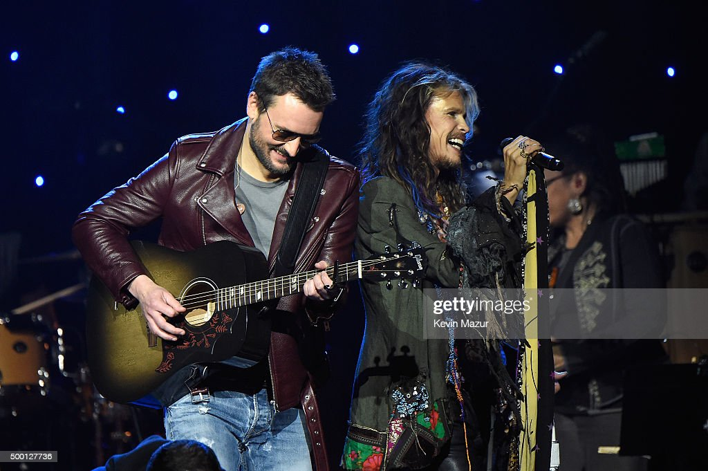 Singers Eric Church and Steven Tyler performs on stage during the Imagine: John Lennon 75th Birthday Concert at The Theater at Madison Square Garden on December 5, 2015 in New York City.