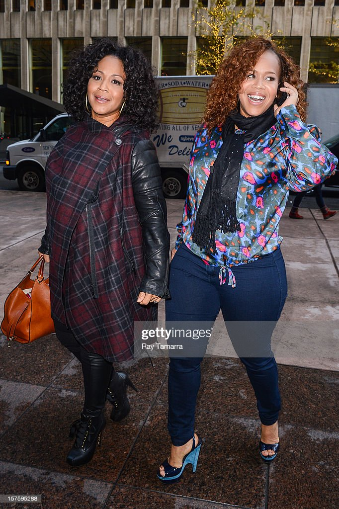 Singers Erica Atkins-Campbell (L) and Trecina Atkins-Campbell, of Mary Mary, enter the Sirius XM Studios on December 4, 2012 in New York City.