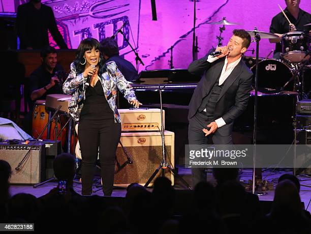 Singers Erica Campbell and Robin Thicke perform onstage during the GRAMMY Foundation's 17th annual Legacy Concert Lean On Me A Celebration of Music...