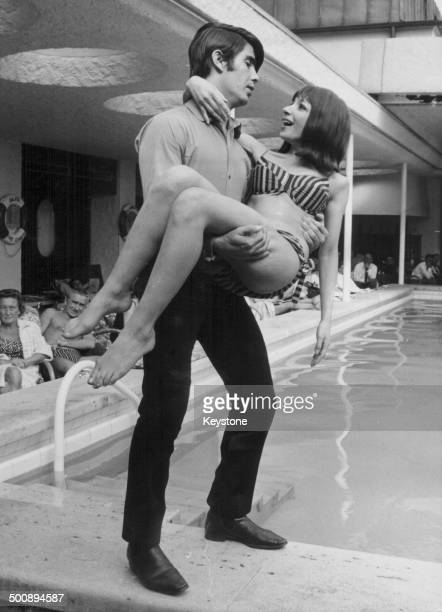 Singers Esther and Abi Ofarim posing next to a swimming pool on a visit to Munich Germany June 3rd 1965