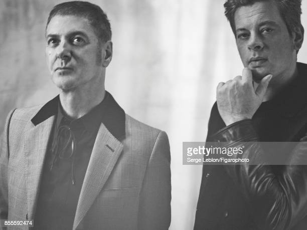 Singers Etienne Daho and Benjamin Biolay are photographed for Madame Figaro on July 23 2017 in Paris France Daho Coat shirt tie Biolay Jacket and...