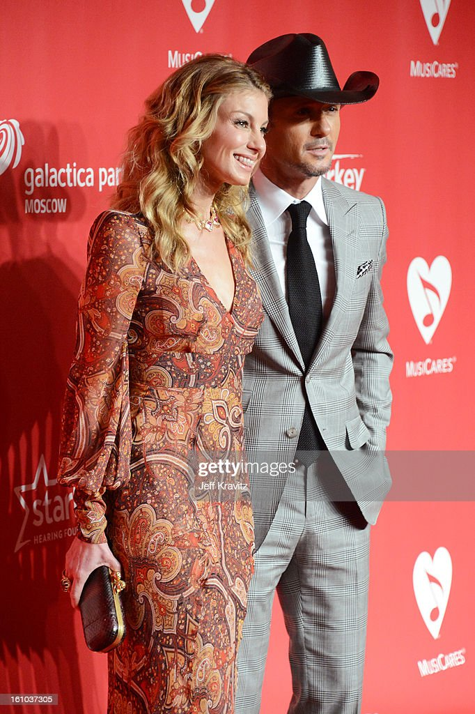 Singers <a gi-track='captionPersonalityLinkClicked' href=/galleries/search?phrase=Faith+Hill&family=editorial&specificpeople=175933 ng-click='$event.stopPropagation()'>Faith Hill</a> (L) and Tim McGraw attend the 2013 MusiCares Person Of The Year Honoring Bruce Springsteen at Los Angeles Convention Center on February 8, 2013 in Los Angeles, California.
