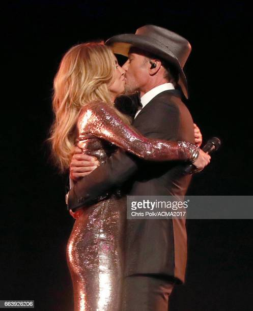 Singers Faith Hill and Tim McGraw kiss onstage during the 52nd Academy of Country Music Awards at TMobile Arena on April 2 2017 in Las Vegas Nevada
