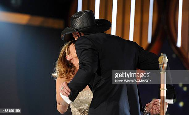 Singers Faith Hill and Tim McGraw perform onstage during the 49th Annual Academy of Country Music Awards at the MGM Grand Garden Arena on April 6...