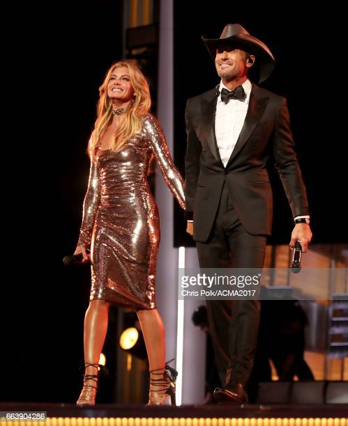 Singers Faith Hill and Tim McGraw perform onstage during the 52nd Academy of Country Music Awards at TMobile Arena on April 2 2017 in Las Vegas Nevada