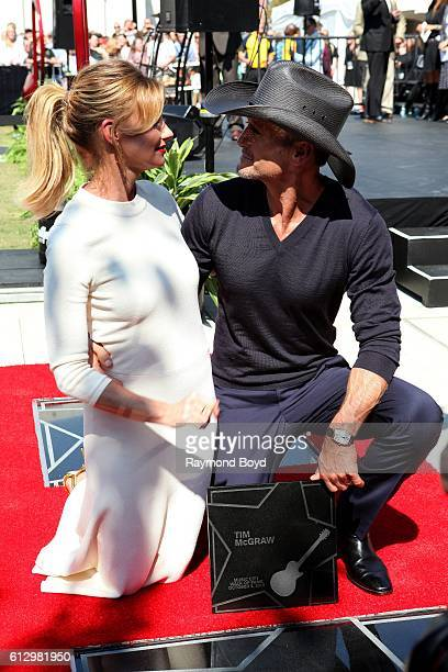 Singers Faith Hill and Tim McGraw poses for photos after Tim received his star on the Music City Walk of Fame in 'Walk of Fame Park' in Nashville...
