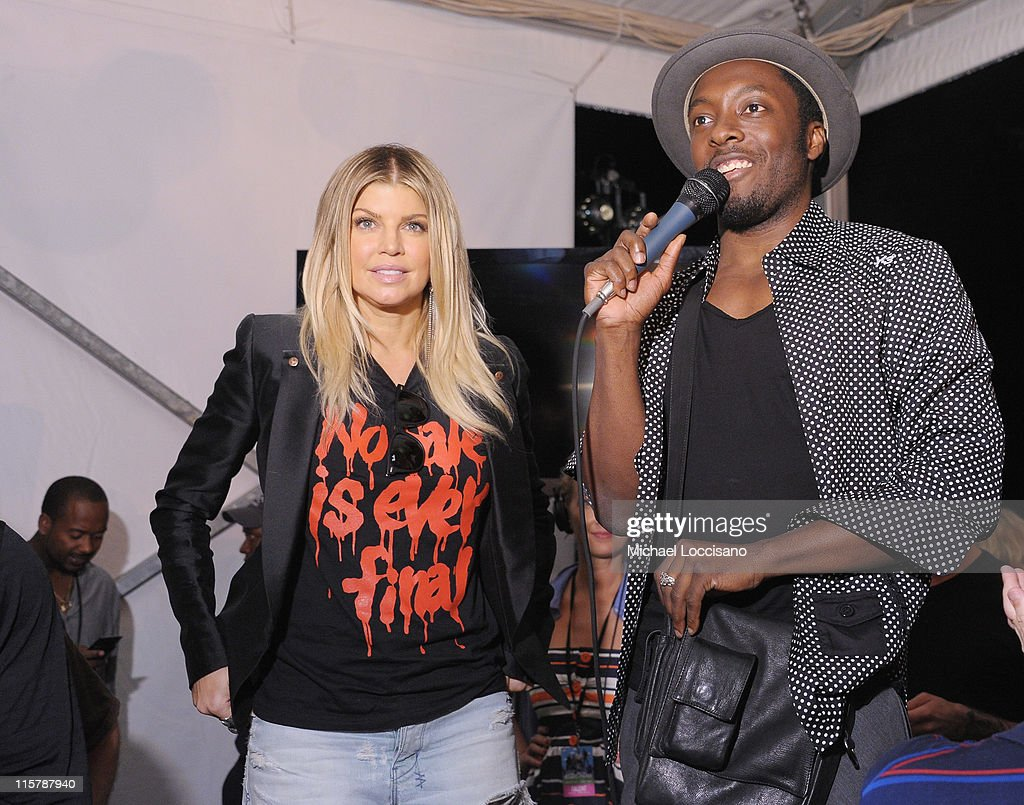 Singers Fergie and will.i.am of the Black Eyed Peas attend the Black Eyed Peas and Friends Concert for NYC to Benefit the Robin Hood Foundation at Central Park, Great Lawn on June 9, 2011 in New York City.