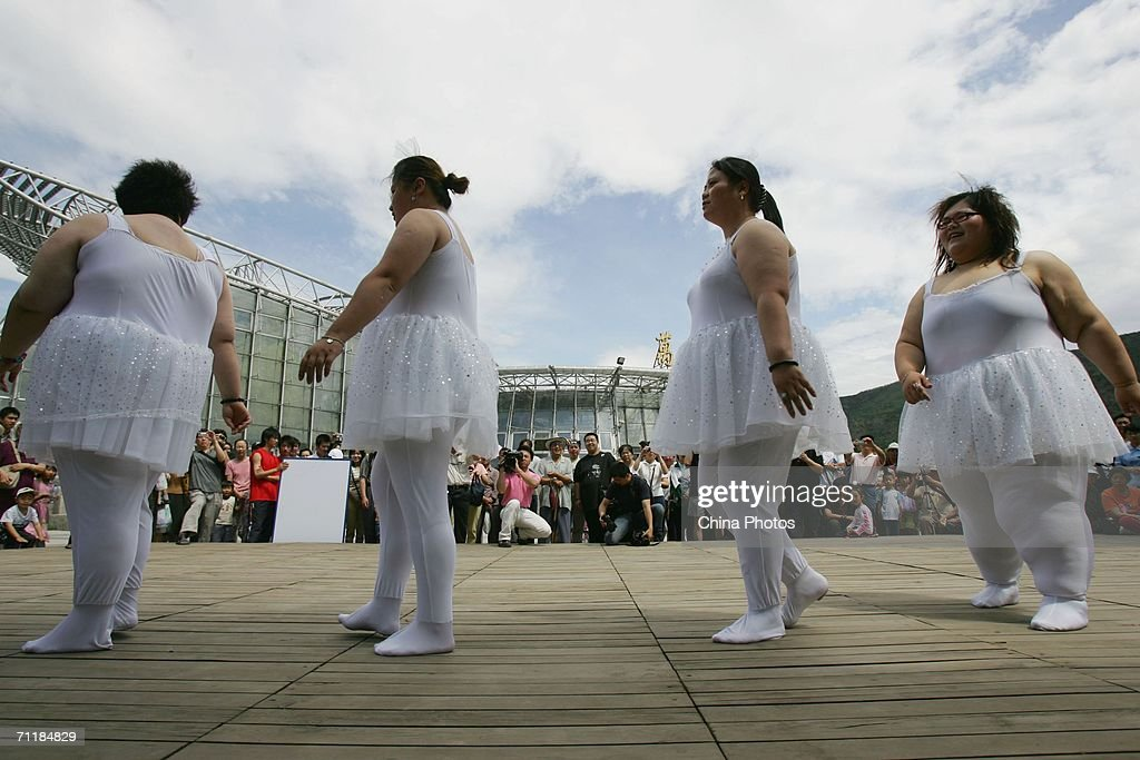 Singers from an obese girl band named 'Qianjin' (in Chinese it means girl or one ton), take part in a dance at the opening ceremony of a club for obese people on June 10, 2006 in Beijing, China. The four girls in the band totally weigh about one ton (about 1102 lbs). An official from the Ministry of Health revealed that more than 200 million Chinese people are overweight.