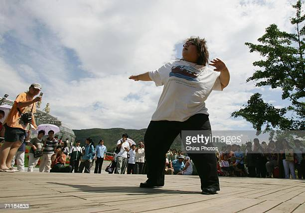A singers from an obese girl band named 'Qianjin' takes part in a dance at the opening ceremony of a club for obese people on June 10 2006 in Beijing...