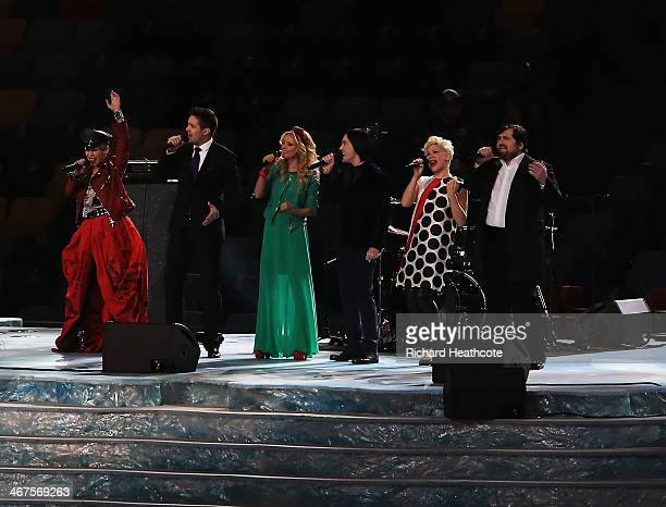 Singers from 'The Voice' Russia perform during the preshow of the Opening Ceremony of the Sochi 2014 Winter Olympics at Fisht Olympic Stadium on...