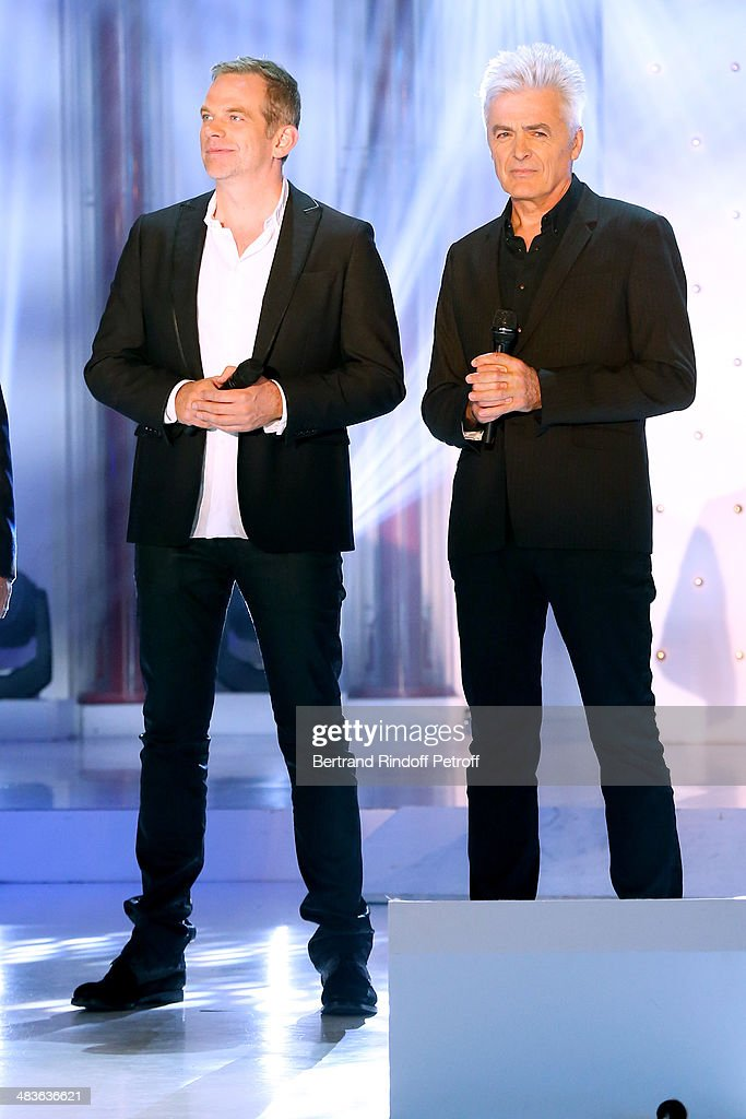 Singers Garou and Daniel Lavoie perform and sing 'Belle' at the 'Vivement Dimanche' French TV Show at Pavillon Gabriel on April 9, 2014 in Paris, France.