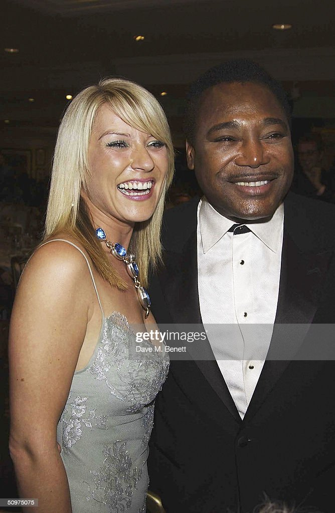 Singers George Benson and actress Zoe Lucker pose with The Raymond Weil International Award at the Nordoff-Robbins O2 Silver Clef Awards at the Inter-Continental Hotel on June 18, 2004 in London.