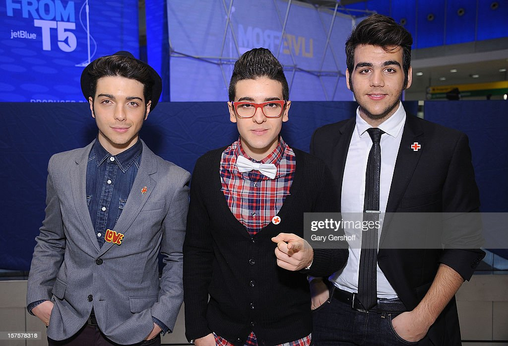 Singers Gianluca Ginoble, Piero Barone and Ignazio Boschetto of ll Volo pose for pictures prior to perfoming at jetBlue Terminal 5 at JFK Airport on December 4, 2012 in New York City.