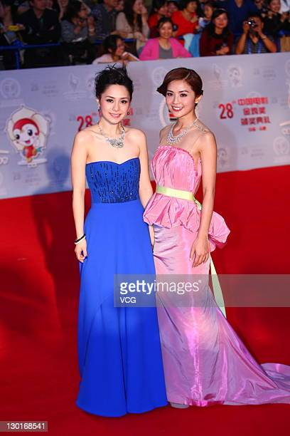 Singers Gillian Chung and Charlene Choi of Hong Kong girl band Twins attend the closing ceremony of the 20th Golden Rooster and Hundred Flowers Film...