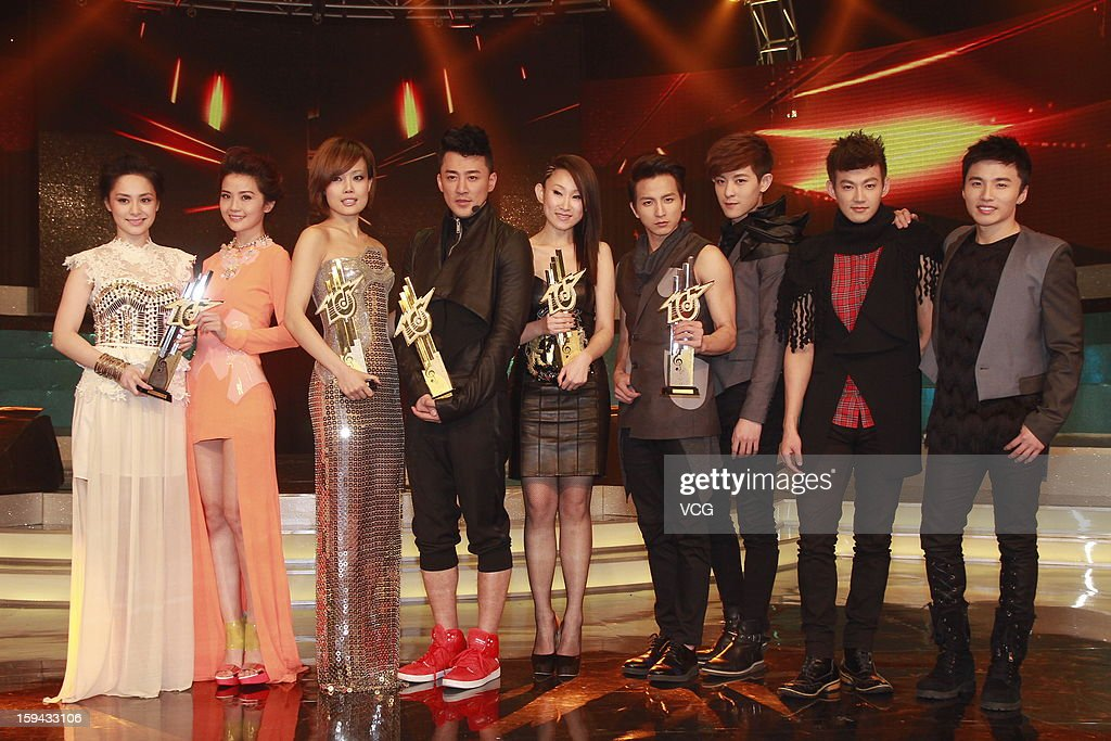 Singers Gillian Chung and Charlene Choi of Twins, Joey Yung, Raymond Lam, Ivana Wong and Taiwanese boy band Lollipop F attend the 2012 Jade Solid Gold Best Ten Music Awards Presentation at TVB City on January 13, 2013 in Hong Kong, Hong Kong.