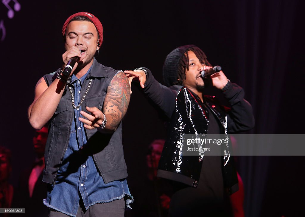 Singers Guy Sebastian and Lupe Fiasco perform during The 55th Annual GRAMMY Awards - Music Preservation Project 'Play It Forward' Celebration highlighting The GRAMMY Foundations ongoing work to safegaurd music's history at the Saban Theatre on February 7, 2013 in Los Angeles, California.