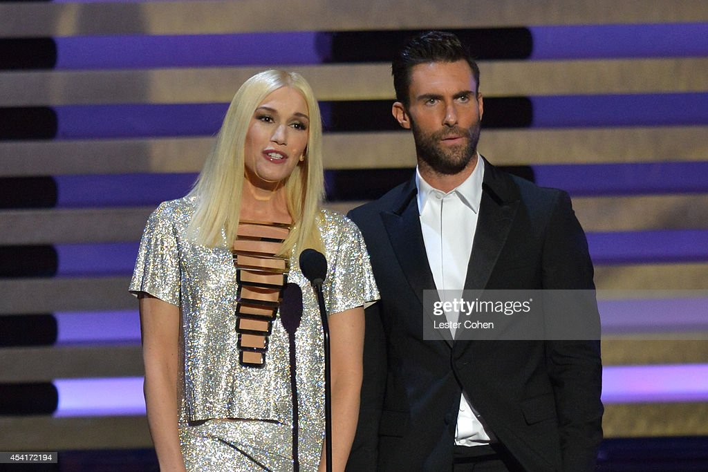 Singers Gwen Stefani (L) and Adam Levine speak onstage at the 66th Annual Primetime Emmy Awards held at Nokia Theatre L.A. Live on August 25, 2014 in Los Angeles, California.