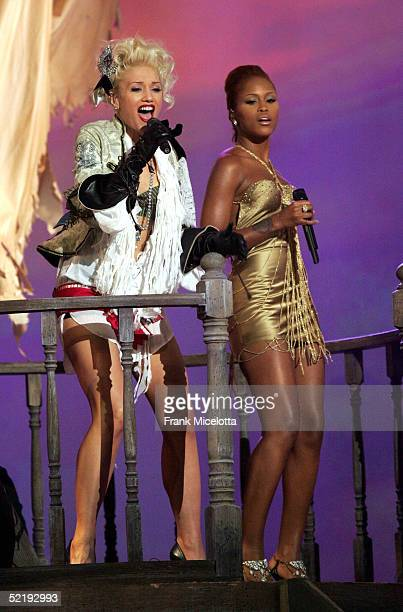 Singers Gwen Stefani and Eve perform onstage during the 47th Annual Grammy Awards at the Staples Center February 13 2005 in Los Angeles California
