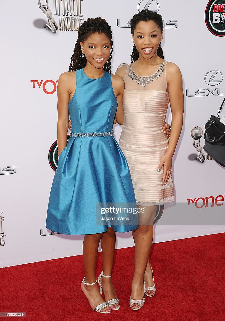 Singers Halle Bailey (L) and Chloe Bailey attend the 45th NAACP Image Awards at Pasadena Civic Auditorium on February 22, 2014 in Pasadena, California.
