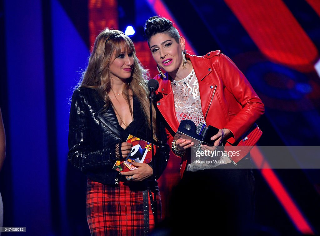 Singers Hanna Nicole Perez Mosa and Ashley Grace Perez Mosa of Ha*Ash recieve award onstage the Univision's 13th Edition Of Premios Juventud Youth Awards at Bank United Center on July 14, 2016 in Miami, Florida.