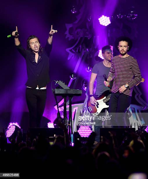 Singers Harry Styles and Liam Payne of One Direction perform onstage during 1061 KISS FM's Jingle Ball 2015 presented by Capital One at American...