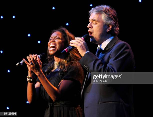 Singers Heather Headley and Andrea Bocelli perform onstage during the launch of The Andrea Bocelli Foundation at the Beverly Hilton Hotel on December...
