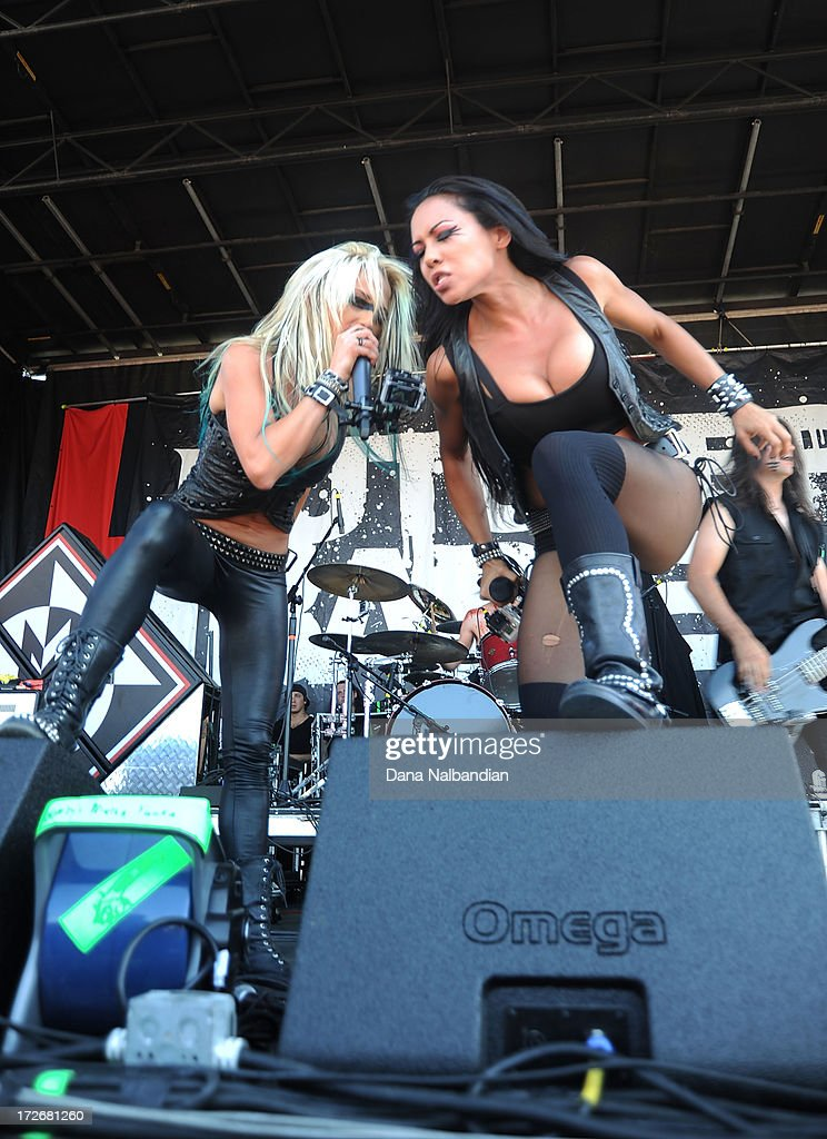 Singers Heidi Shepherd and Carla Harvey of Butcher Babies perform at White River Amphitheater on July 3, 2013 in Auburn, Washington.