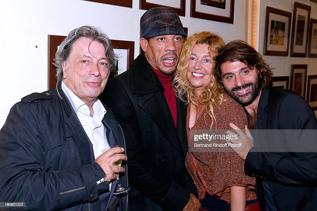 Singers <a gi-track='captionPersonalityLinkClicked' href=/galleries/search?phrase=Herve+Vilard&family=editorial&specificpeople=2024864 ng-click='$event.stopPropagation()'>Herve Vilard</a>, JoeyStarr (Didier Morville), director Stephanie Murat and her companion after 'Nina' : Premiere at Theatre Edouard VII on September 16, 2013 in Paris, France.