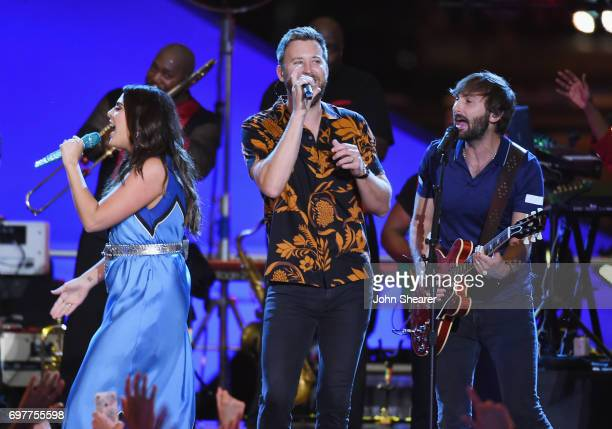 Singers Hillary Scott Charles Kelley and Dave Haywood of Lady Antebellum perform onstage with Earth Wind Fire during CMT Crossroads Earth Wind Fire...