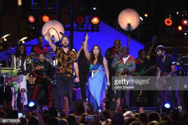 Singers Hillary Scott Charles Kelley and Dave Haywood of Lady Antebellum perform onstage with Verdine White Philip Bailey of Earth Wind Fire during...