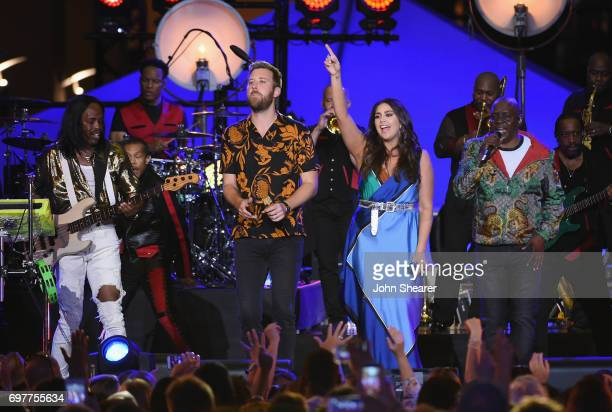 Singers Hillary Scott Charles Kelley of Lady Antebellum perform onstage with Verdine White Philip Bailey of Earth Wind Fire during CMT Crossroads...