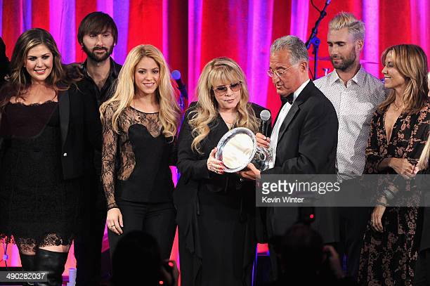 Singers Hillary Scott Dave Haywood Shakira Del Bryant BMI President singers Adam Levine of Maroon 5 and Sheryl Crow present the 2014 BMI Icon Award...