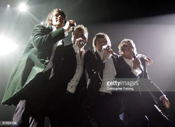 Singers Howard Donald Gary Barlow Mark Owen and Jason Orange of Take That perform on stage as part of the band's 'Ultimate Tour 2006' at Manchester...