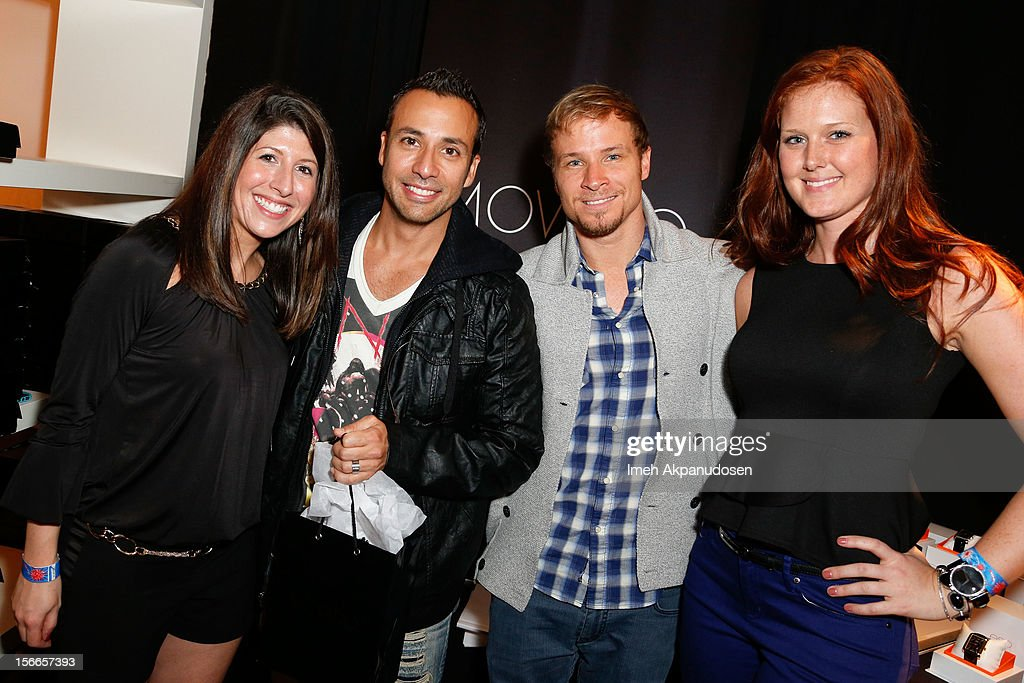 Singers <a gi-track='captionPersonalityLinkClicked' href=/galleries/search?phrase=Howie+Dorough&family=editorial&specificpeople=204770 ng-click='$event.stopPropagation()'>Howie Dorough</a> (2nd left) and <a gi-track='captionPersonalityLinkClicked' href=/galleries/search?phrase=Brian+Littrell&family=editorial&specificpeople=215310 ng-click='$event.stopPropagation()'>Brian Littrell</a> (2nd right) from the musical group Backstreet Boys attend The Official AMA Artist Gift Lounge presented by LPB Group at Nokia Theatre L.A. Live on November 17, 2012 in Los Angeles, California.