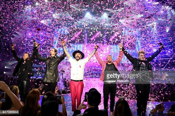 Singers Howie Dorough Kevin Richardson AJ McLean Brian Littrell and Nick Carter of the Backstreet Boys perform during the launch of the group's...