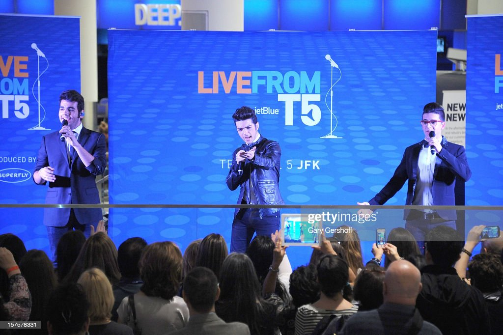 Singers Ignazio Boschetto, Gianluca Ginoble and Piero Barone of ll Volo perform at jetBlue Terminal 5 at JFK Airport on December 4, 2012 in New York City.