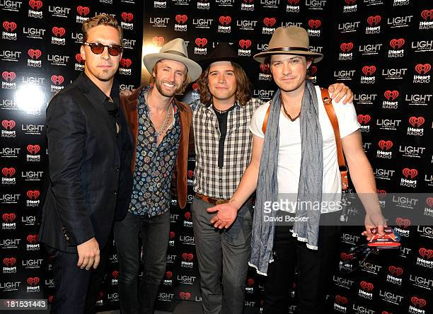 Singers Isaac Hanson Paul McDonald Zac Hanson and Taylor Hanson arrive at the iHeartRadio Music Festival official closing party at the Light...