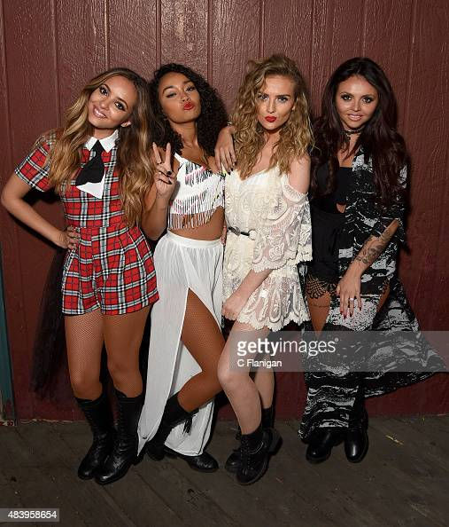 Singers Jade Thirlwall LeighAnne Pinnock Perrie Edwards and Jesy Nelson of Little Mix pose backstage during the 997 NOW Summer Splash at California's...