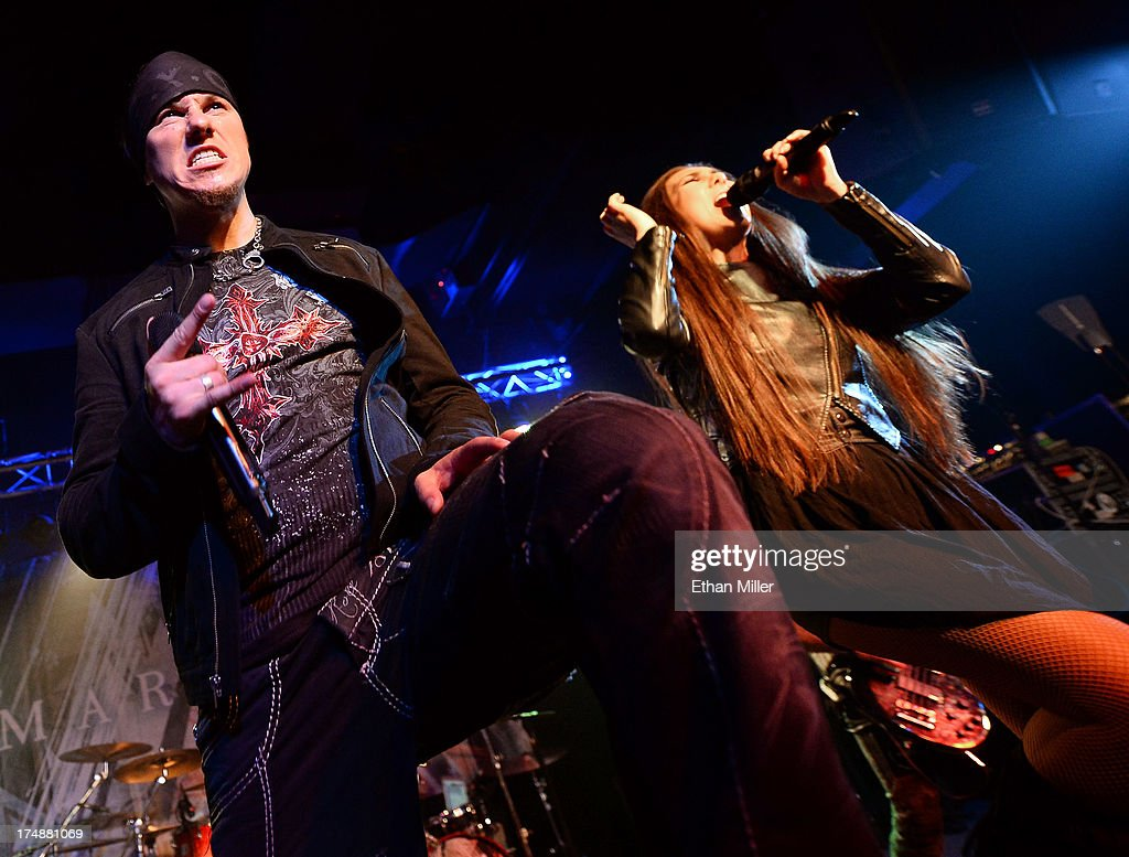 Singers Jake E (L) and Elize Ryd of Amaranthe perform at the LVCS as the band tours in support of the new album 'The Nexus' on July 28, 2013 in Las Vegas, Nevada.