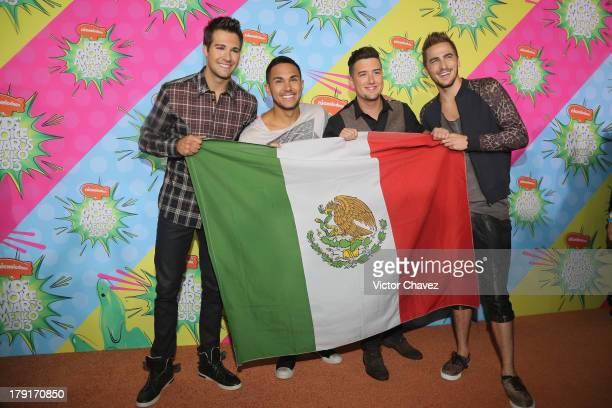 Singers James Maslow Logan Henderson Kendall Schmidt and Carlos Roberto Pena Jr of Big Time Rush arrive at Kids Choice Awards Mexico 2013 at Pepsi...
