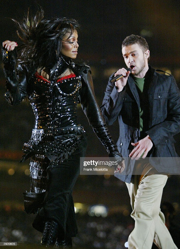 Singers <a gi-track='captionPersonalityLinkClicked' href=/galleries/search?phrase=Janet+Jackson&family=editorial&specificpeople=156414 ng-click='$event.stopPropagation()'>Janet Jackson</a> and surprise guest <a gi-track='captionPersonalityLinkClicked' href=/galleries/search?phrase=Justin+Timberlake&family=editorial&specificpeople=157482 ng-click='$event.stopPropagation()'>Justin Timberlake</a> perform during the halftime show at Super Bowl XXXVIII between the New England Patriots and the Carolina Panthers at Reliant Stadium on February 1, 2004 in Houston, Texas.