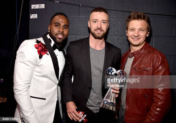 Singers Jason Derulo and Justin Timberlake winner of the Song of the Year award for 'Can't Stop The Feeling' and actor Jeremy Renner attend the 2017...