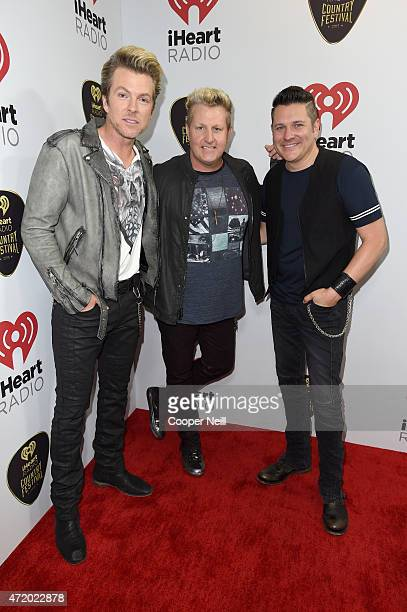 Singers JD Rooney Gary LeVox and Jay DeMarcus of Rascal Flatts pose backstage at the 2015 iHeartRadio Country Festival at The Frank Erwin Center on...